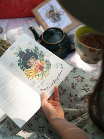Girl reading a herbal recipe booklet