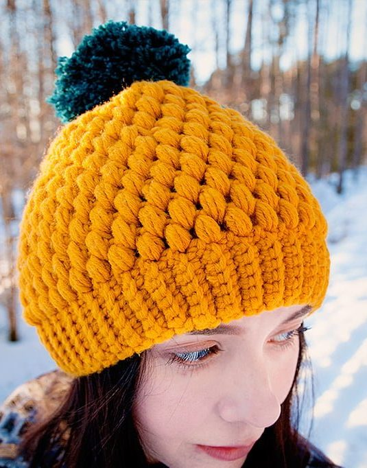 Girl with mustard colored beanie