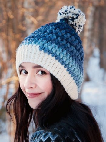 White and blue beanie with pompom