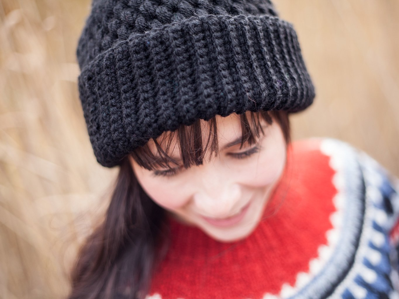 Smiling girl with double brimmed black beanie