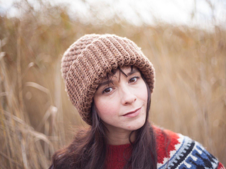 Girl with long hair wearing a brown crochet beanie