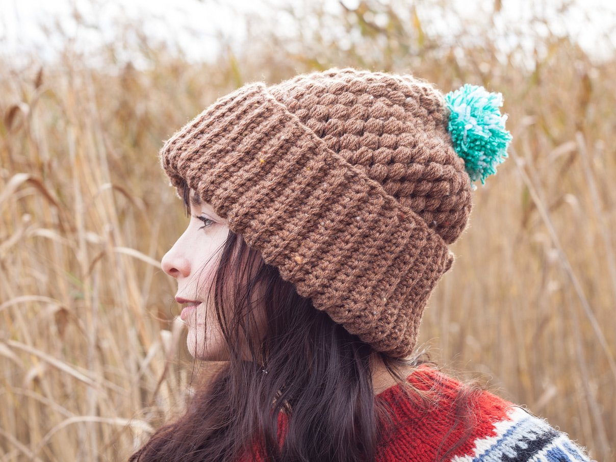 Side view of a girl wearing a brown beanie