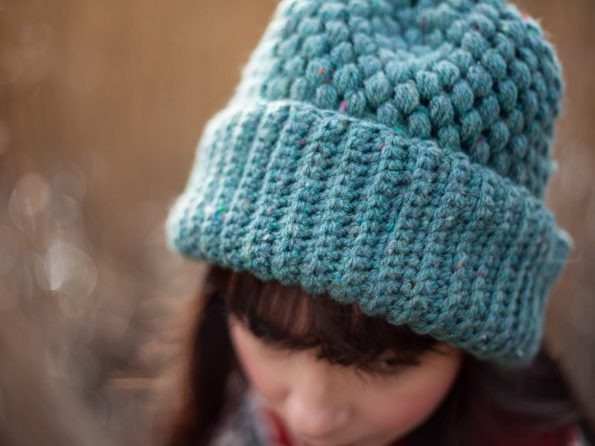 Closeup of crocheted vegan green beanie