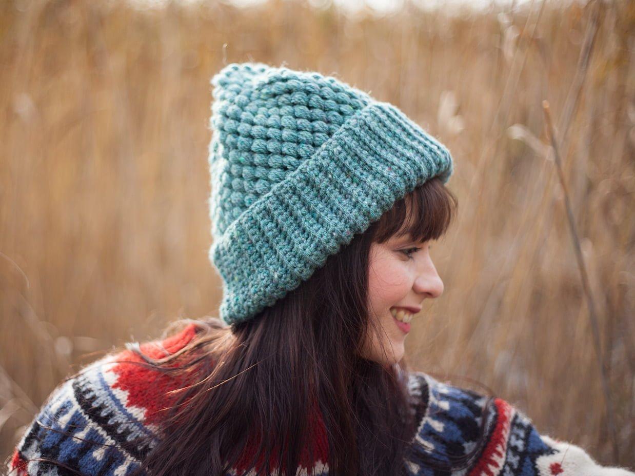 Girl with crochet vegan beanie smiling