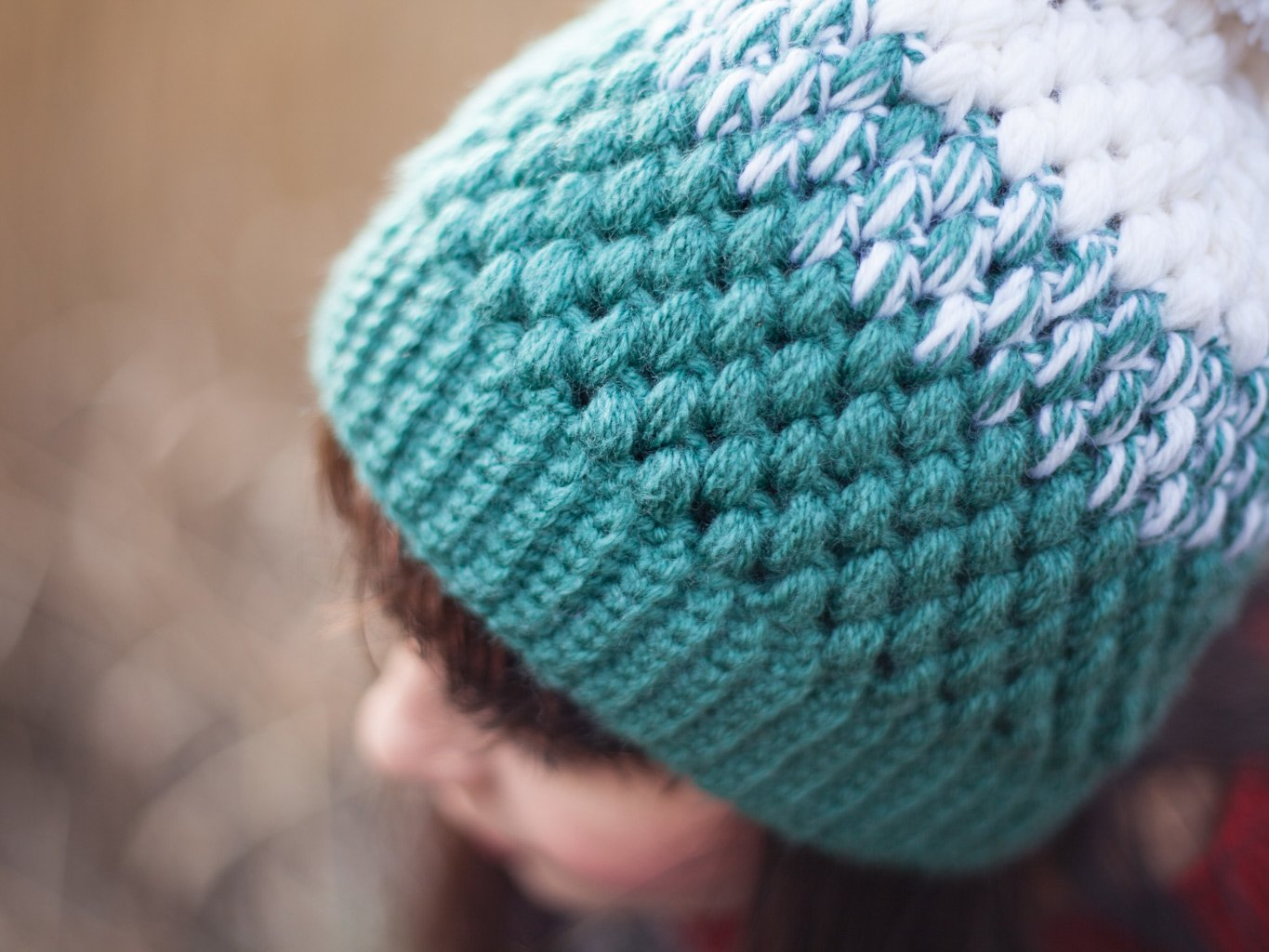 closeup of white mint crochet beanie