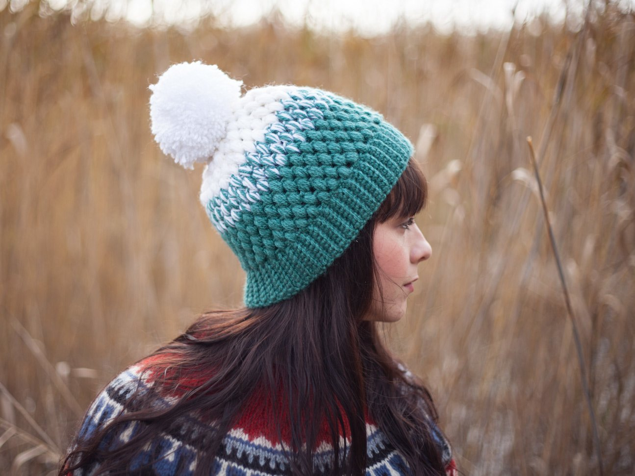 Girl with long hair wearing a white and mint colored crochet beanie by warmsquirrel.