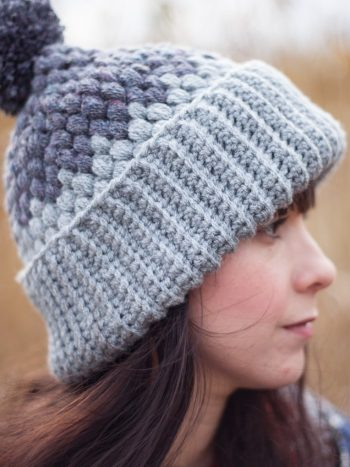 Side view of a girl wearing a gray crochet beanie