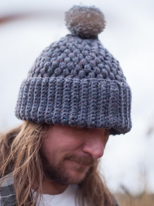 Long haired man with gray beanie