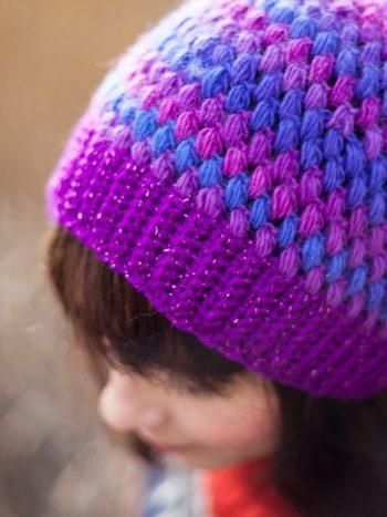Closeup of violet crochet beanie