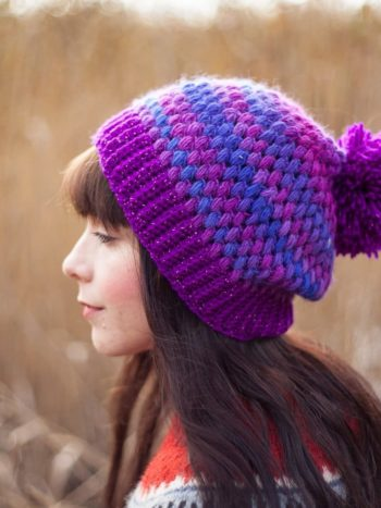 Girl with long hear wearing a slouchy violet beanie