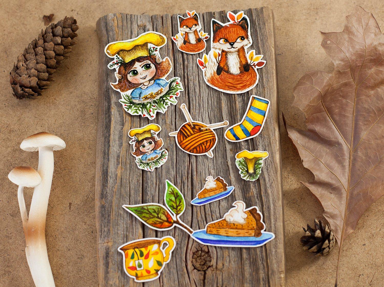 Image of an Autumn sticker set that includes fox, tea cup, wool, socks, leaves, pumpkin pie, chanterelle mushroms