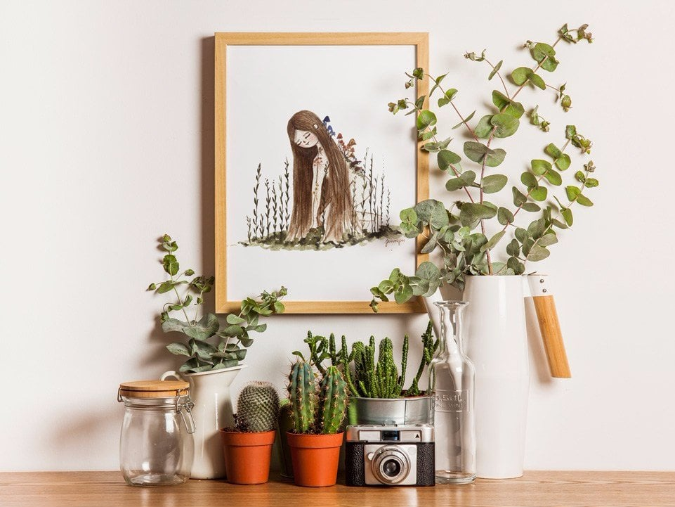 picture of a plant girl watercolor print in A3 size surrounded by plants and decoration