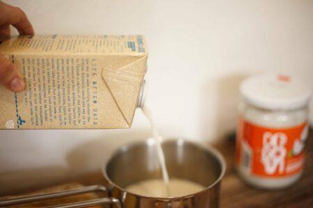 Pouring milk for preparing turmeric latte