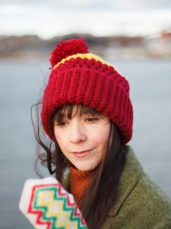 Girl with long hair and a vegan beanie is gryffindor colors by warmsquirrel