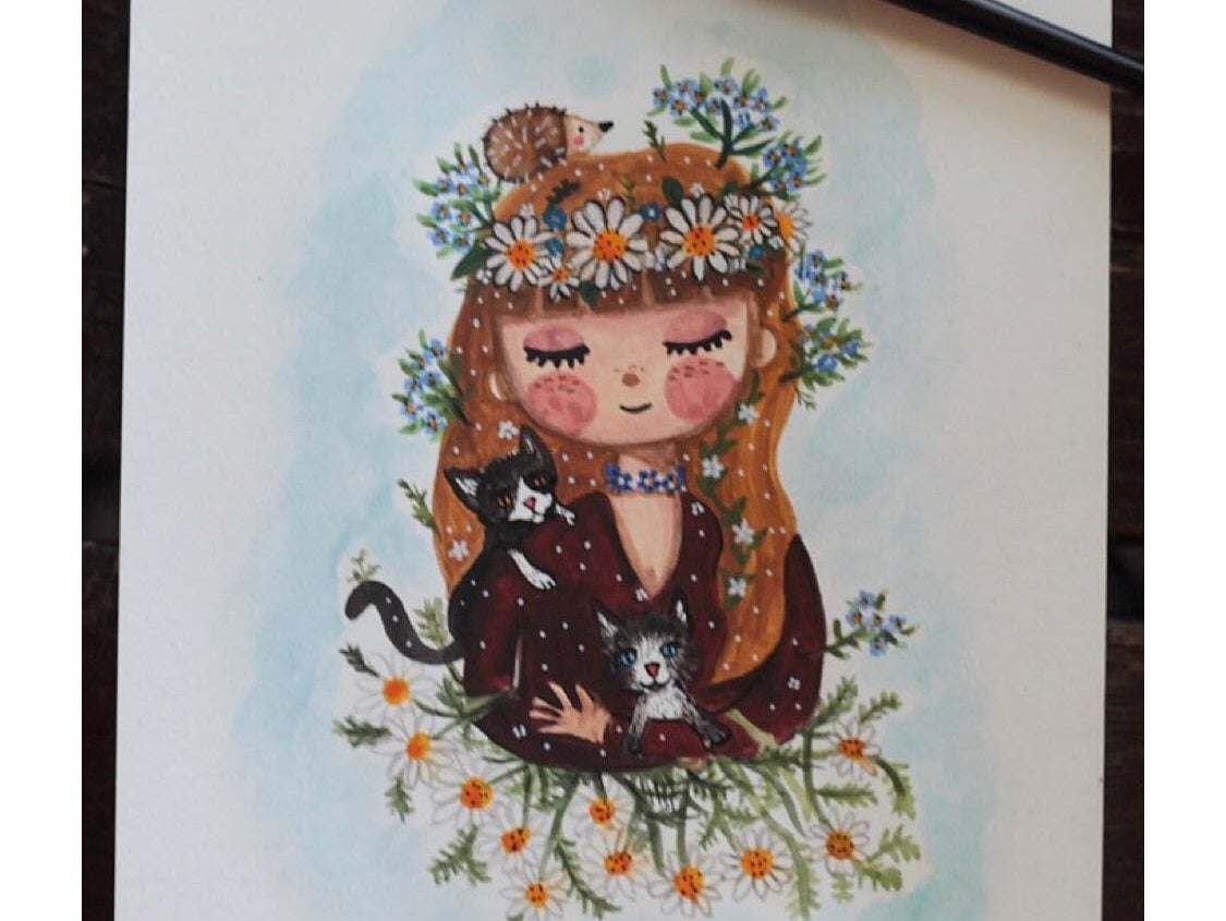 custom watercolor portrait of a girl with a flower crown holding a cat.