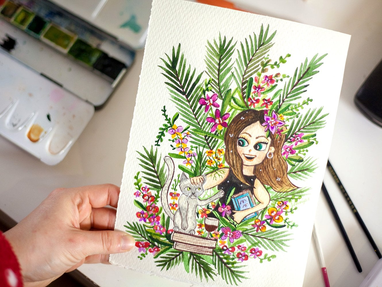 Custom watercolor portrait of a girl with an orchid in her hair. She is petting her gray cat and holding a book.