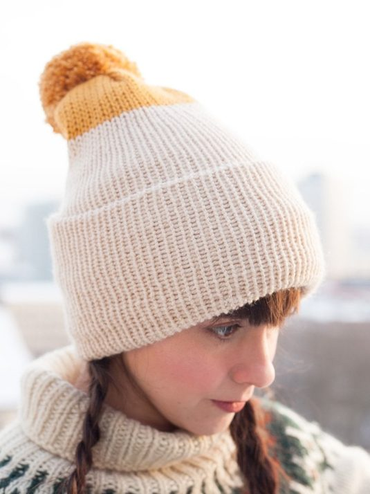 Font view of mustard and beige beanie