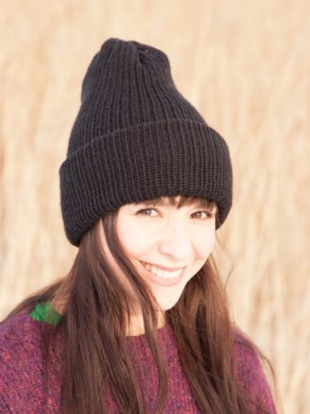 Girl wearing a Black colored Vegan Beanie with double brim.