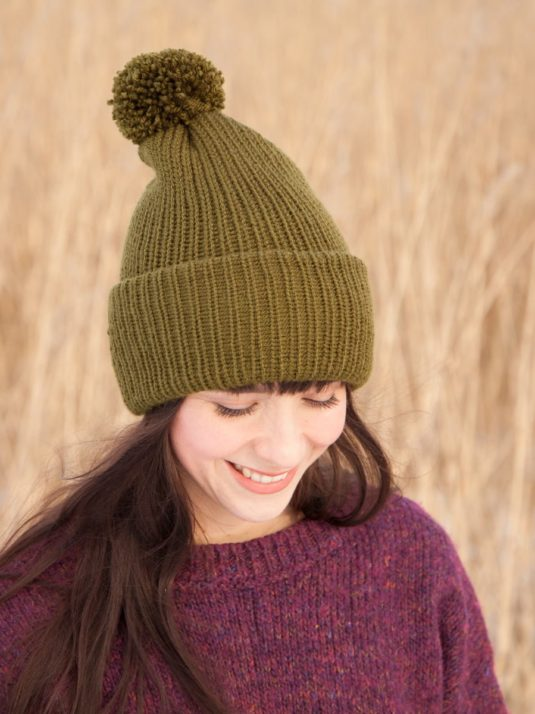 Girl wearing Vegan Beanie with pompon