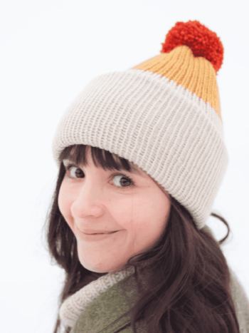 Jenn smiling and wearing mustard copper and beige vegan beanie by warmsquirrel