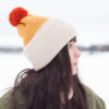 Side view of jenn wearing mustard copper and beige vegan beanie by warmsquirrel