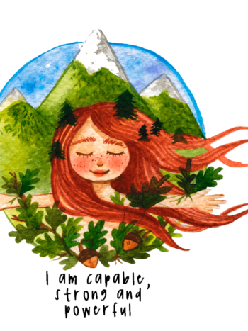 Red head girl with mountains in the background