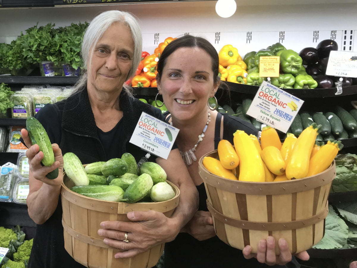 Two women with they organic local produce