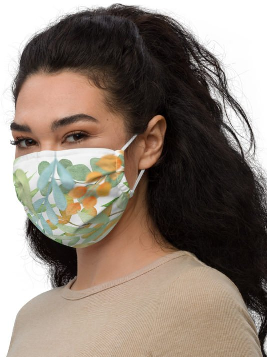 Woman with dark hair wearing a Reusable facemask in Covid-19.